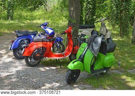 Villaggio Di Punta Sdobba, Italy - June 14 2020. Four Vespas, Part Of A Small Rally Of Vespa Motorik