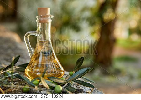 olive oil and green olives outdoor
