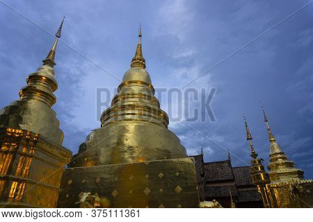 Wat Phra Singh Landmark Of Chiangmai, Thailand At Dusk.