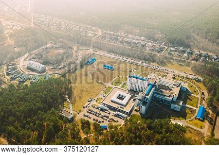 Aerial View Of Building Of Hospital In Spring Sunny Day. Top View. Drone View. Birds Eye View.