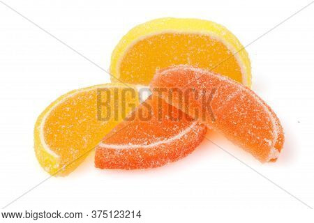 Composition Of Marmalade Candy In Shape Of Citrus Fruits Wedges. Yellow And Orange Jelly Sweet Candi