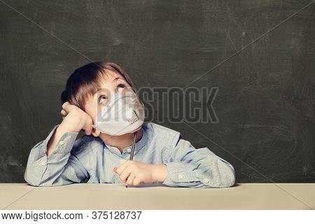 Child Boy Student In Protective Medical Mask On Black Background With Copy Space