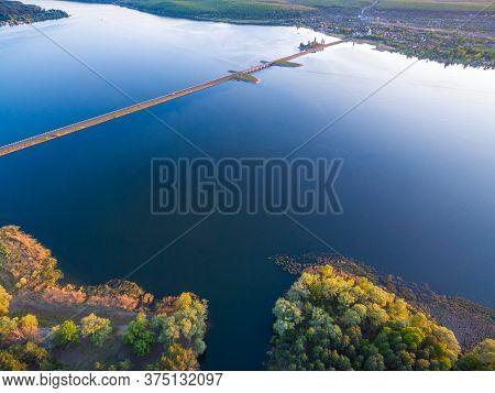 Aerial Panoramic View To Long Dam With Bridge At Severskiy Donets River, Pechenegi Reservoir, Ukrain