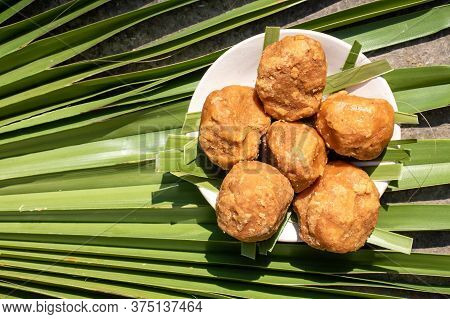 Top View Of Sweet Palm Jaggery In A Plate Isolated On A Palm Leaf