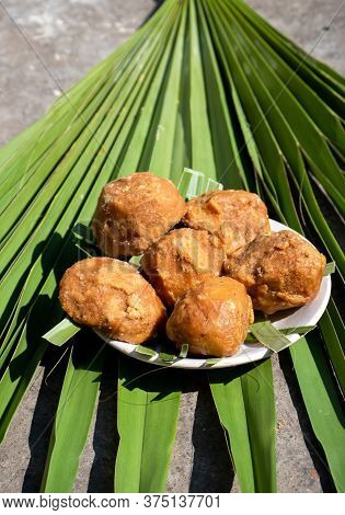 Palm Jaggery In A Plate Isolated On A Palm Leaf In Vertical Orientation