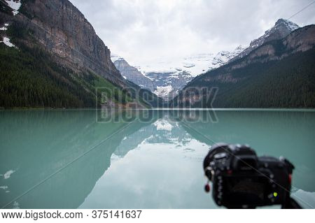 A Out-of-focus Camera In The Foreground And Lake Louise In The Background.  Ab Canada