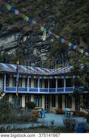 Colorful Tea House Lodge With Prayer Flags In Dharapani, Marshyangdi River Valley Gorge, Annapurna C