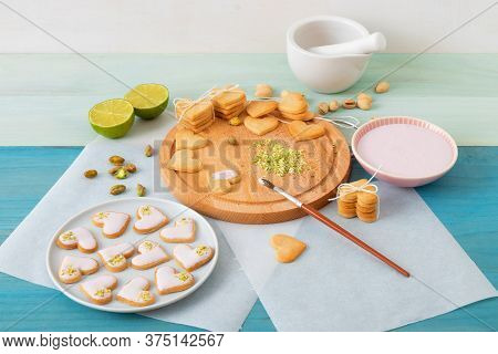 Prepare For Valentines Day. Iced Spicy Shortbread Cookies In Heart Shapes, Embellished With Lime-ras