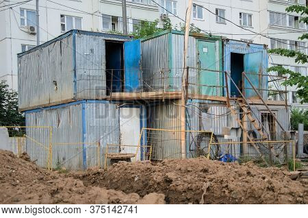 Temporary Residential Metal Buildings For Workers In Urban Construction. Horrible Working Conditions