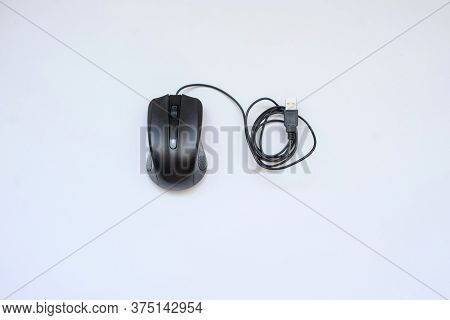 A Black Mouse Of Computer, White Background