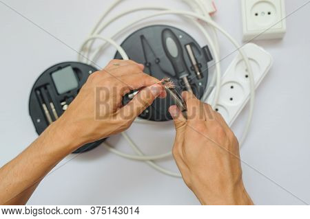 The Work Process Of An Electrician, Close View, White Background.