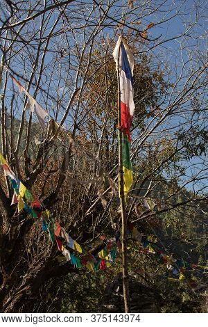 Colorful Buddhist Prayer Flags Hanging, Blowing In The Wind By The Mountains