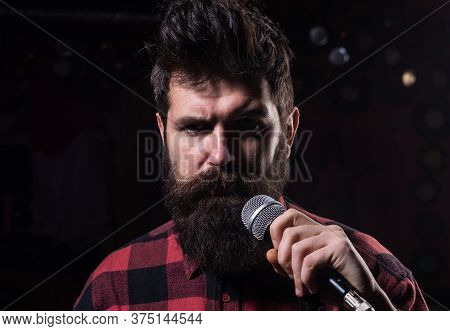 Vocalist Concept. Man With Tense Face Holds Microphone,
