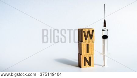 Win Word Written On Wood Block. Win Text On Wooden Table For Your Desing, Concept.