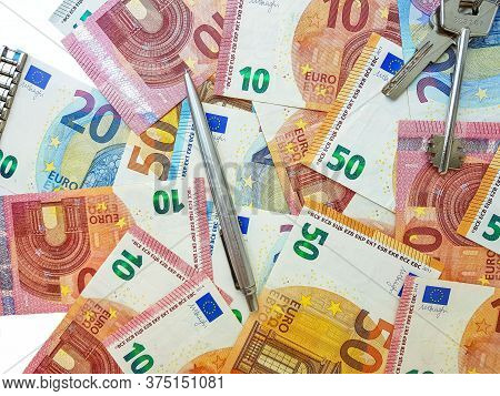 Paper Money Of The Euro On A White Background Neatly Laid Out, Straight, Smooth. Denomination Twenty