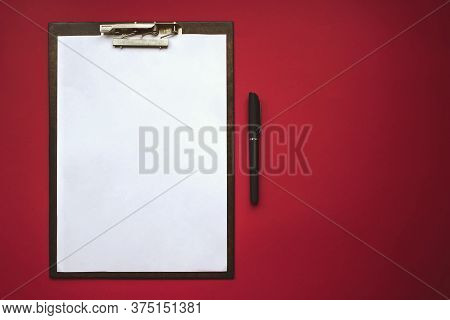 Plastic Tablet With White Sheet Of Paper On The Red Background. Top View. Concept Of New Opportuniti