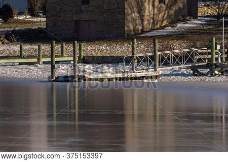 Unused Docks Hemmed In By Salt Water Ice Along Fairhaven Shoreline Of The Acushnet River