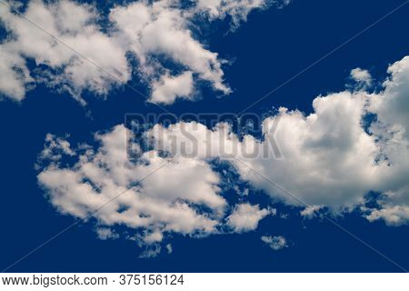 Contrast Cumulus Clouds. A Group Of Clouds On A Blue Windy Sky. Natural Sky Background.