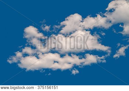 White Cumulus Clouds. A Group Of Clouds On A Blue Windy Sky. Natural Sky Background.