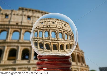 View Of The Roman Coliseum Through A Glass Transparent Ball Rome, Italy