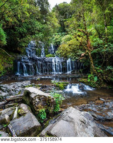 Southern Scenic Route. Picturesque and magnificent waterfalls Purakaunui Falls. New Zealand, South Island. The concept of active, environmental and photo tourism