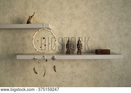 Stylish And Modern Element Of Interior. Wall Shelf With Home Decor Statuettes, Dream Catcher And Jew