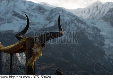 Animal Horns On A Stick In Front Of A Snowy Mountain With Bright Sun, Manang Village, Annapurna Circ