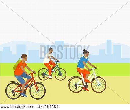 Family Rides Bicycles In A Park Outside The City. Mom Son And Dad Are Actively Spending Summer Vacat