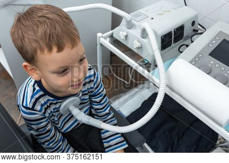 Electro Stimulation In Physical Therapy To Child. Medical Procedure In A Physiotherapy Clinic. Elect