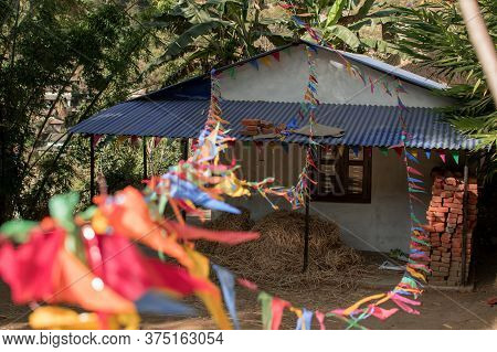 Buddhist Praying Flags Attatched To A Small House In A Nepalese Village, Annapurna Circuit