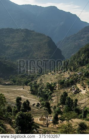 View Over Huts And Terraced Rice Fields At Annapurna Circuit In Nepal