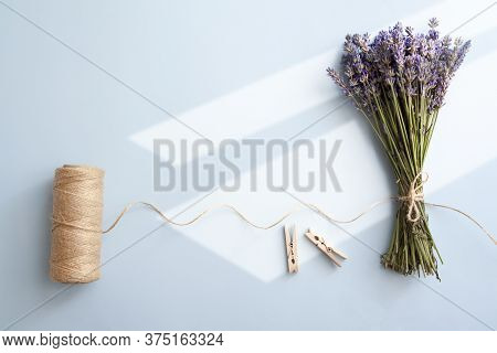 Lavender Bunch And Twine On A Blue Background