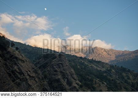 Beautiful Scenery With The Moon Over Mountain Peaks Of Annapurna Circuit During The Day