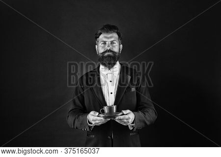 Caffeine Loading Please Wait. Serious Butler Hold Coffee Cup. Bearded Man With Hot Drink. Caffeine E