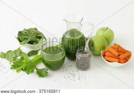 Vegetable Smoothie, Healthy Organic Juice Made From Celery, Green Apples, Leaves Of Spinach And Youn