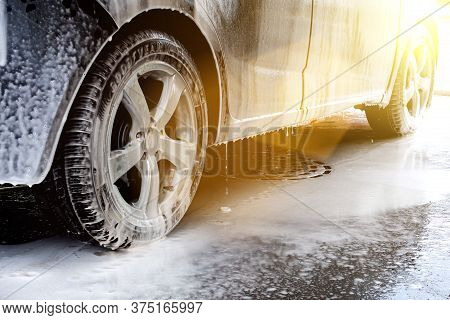 Car Washing. Cleaning Car Using High Pressure Water. Contactless Self-service Car Wash. Concept Disi