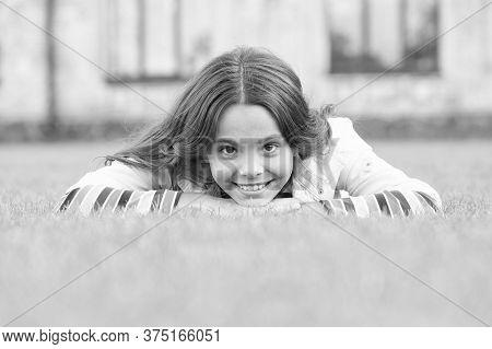 Look At Her Now. School Break For Rest. Adorable Pupil. Girl Kid Laying Lawn. Girl School Uniform En