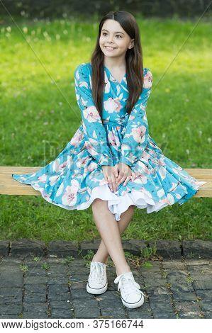 Summer Look Inspiration. Happy Kid Sit On Park Bench. Beauty Look Of Cute Girl. Fashion Look Of Litt