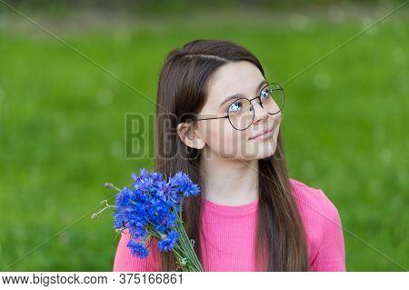 Beauty And Nature Have Strong Connection. Little Child Hold Flowers Summer Outdoor. Baby Skin. Summe