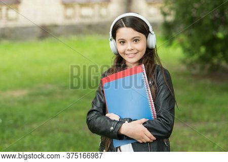 English Learning Courses. Happy Girl Learn English. Little Child Hold English Books. Listening Compr