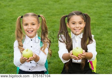 Knowledge Is Knowing Apple Is Fruit. Happy Girls Hold Apples On Green Grass. Green Apples For School