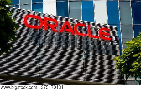 Bucharest, Romania - June 25, 2020: Oracle Logo Is Seen On Top Of An Architectural Metal Fence At Gr