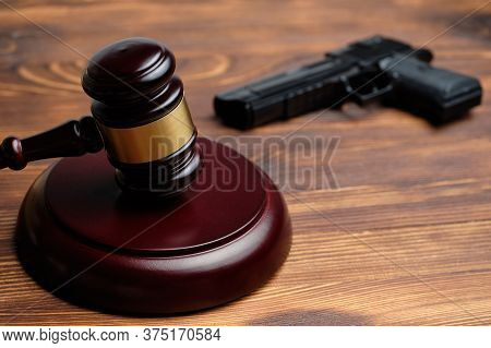 Judge Hammer On A Background Of The Gun As A Concept Court Sentence For Murder.
