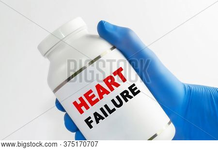 Heart Insufficiency Inscription On A Bottle With Medicine In A Gloved Hand.