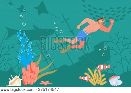 Young Man In Diving Mask Watching Marine Fauna During Swimming In Sea Or Ocean. Snorkeler Observing