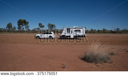 Undara To Townsville Highway, Queensland, Australia - June 2020: Car And Caravan Parked On Site Of O