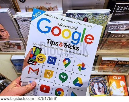 Montreal, Canada - June 30, 2020: Google Tips And Tricks Unofficial Magazine With Google Icons On Th