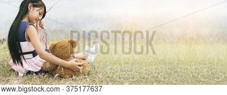 Banner Happy Child Hug Teddy Bear In Green Park Playground. Teddy Bear Best Friend For Little Girl.