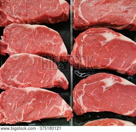 Fresh Raw Beef Rib Eye Steak For Sale In Grocery Store