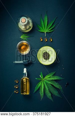Cbd Oil, Tincture With Hemp Leaves On A Black Background. Different Bottles With A Pipette And Marij